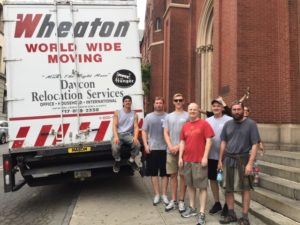 Davcon moving crew in front of moving truck