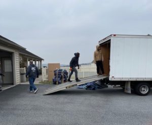 a man walking up a ramp into a moving truck